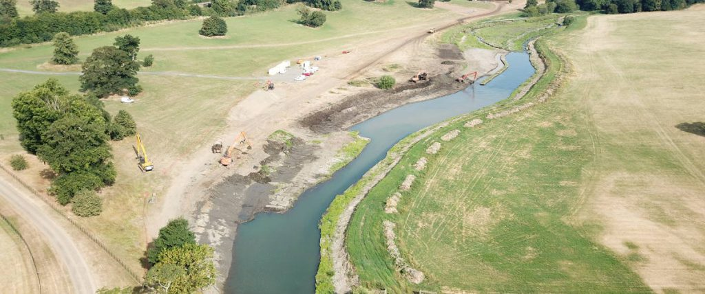 Restoration of the River Beane in Rural Hertfordshire with diggers in river